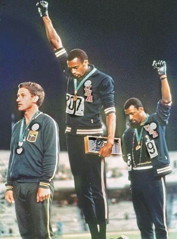 US athletes, Tommie Smith and John Carlos. They are AFRICAN-AMERICANS